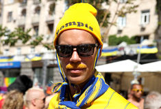 Sweden fan with painted mustache Royalty Free Stock Photography