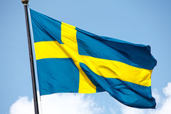 Sweden flag. Swedish / Sweden flag flying against blue sky stock photography