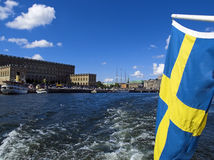 Sweden flag. Royal Palace view from the ship Royalty Free Stock Image