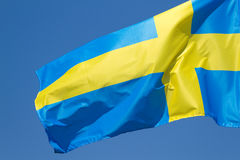 Sweden flag. On the blue sky Royalty Free Stock Images