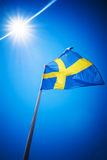 Sweden flag against blue sky in bright sunshine Stock Photography