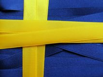 SWEDEN flag or banner. Made with blue and yellow ribbons Stock Photos