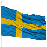 Sweden Flag on Flagpole. Flying in the Wind, Isolated on White Background royalty free stock image