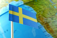 Sweden flag with a globe map as a background Stock Photography
