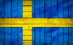 Sweden flag painted on wooden boards Stock Images