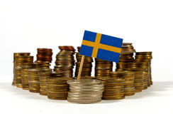 Sweden flag with stack of money coins. Sweden flag waving with stack of money coins royalty free stock photos
