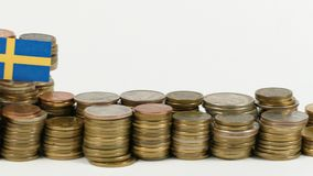 Sweden flag with stack of money coins. Sweden flag waving with stack of money coins stock video footage