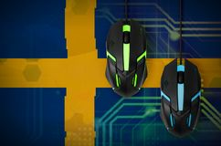 Sweden flag and two mice with backlight. Online cooperative games. Cyber sport team. Sweden flag and two modern computer mice with backlight. The concept of royalty free stock images