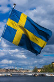 Sweden flag. Waving in the wind in the center of Stockholm Stock Photos