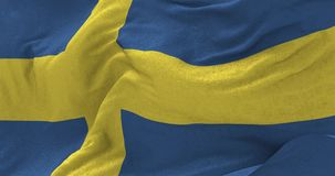 Sweden Flag in the Wind. Close up Sweden flag blowing in the wind, looped slowmotion, 4K stock footage