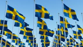 Sweden flags waving in the wind Stock Photo