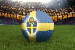 Sweden football team ball on big stadium background with Sweden Team logo competition concept. Sweden flag on ball team tournament. In Russia. Sport competition Royalty Free Stock Images
