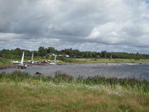 Sweden Halmstad Water Houses sailing boats summer cloud grass grey Stock Photos
