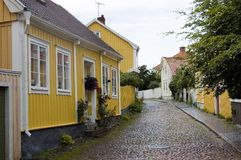Sweden Kalmar Street with hist. Sweden kalmar View of a street with painted wooden houses in a typical Swedish style Royalty Free Stock Photos