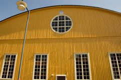 Sweden Karlskrona Army shed. Sweden karlskrona Historic yellow airplane shed on the naval base of the island Stumholm Royalty Free Stock Image