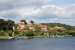 Sweden Karlskrona Island with typical old houses. Sweden Karlskrona View of an island with typical houses known as Colony Houses. Best known panorama of Sweden Royalty Free Stock Photos