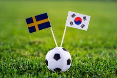 Sweden - Korea Republic, South Korea, Group F, Monday, 18. June, Football, World Cup, Russia 2018, National Flags on green grass,. White football ball on ground royalty free stock photo