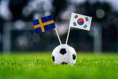Sweden - Korea Republic, South Korea, Group F, Monday, 18. June, Football, World Cup, Russia 2018, National Flags on green. Grass, white football ball on ground stock images