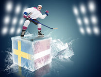 Sweden - Latvia game. Spunky hockey player on ice cube Stock Images