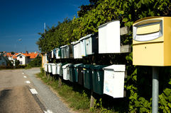 Sweden Mail boxes. All the mail boxes of one street in a row.This is a usual view in Sweden and very convenient for the postman, too stock image