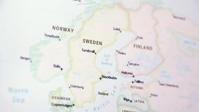 Sweden on a Map. Sweden on a political map of the world. Video defocuses showing and hiding the map stock footage