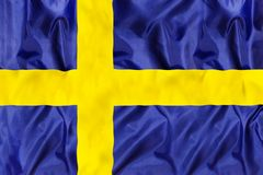 Sweden national flag with waving fabric stock photography
