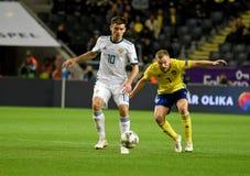 Sweden national team midfielder Sebastian Larsson and Russia national team midfielder Ruslan Kambolov stock image