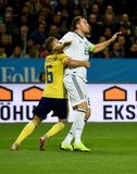 Sweden national team player Ludwig Augustinsson and Russia national team striker Artem Dzyuba. Solna, Sweden - November 20, 2018. Sweden national team player royalty free stock image