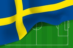 Sweden national waving flag on football field background. Sweden national waving flag. Symbol of Sverige on football field background Royalty Free Stock Photo