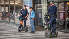 Sweden police on duty near culture house, using segway, Stockholm, Sweden, august 2018 royalty free stock image