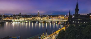 Sweden, Sotckholm City Skyline During Late Sunset, view from Old Town. Pier to Sodermalm district royalty free stock photos