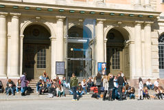 Sweden. Stockholm. Gamla Stan. Swedish Academy. Young people sitting near the Swedish Academy. This building also houses the Nobel Library and the Nobel Museum Stock Photos