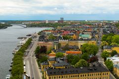 Sweden Stockholm. View of the cityscape, bridges and pier with boats from observation deck of Town Hall royalty free stock photography
