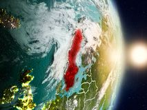 Sweden during sunrise. Highlighted in red on planet Earth with visible country borders. 3D illustration. Elements of this image furnished by NASA Stock Photos