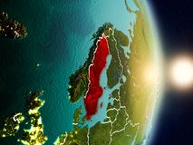 Sweden during sunrise. Highlighted in red on planet Earth with visible country borders. 3D illustration. Elements of this image furnished by NASA Royalty Free Stock Photo
