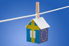 Sweden, swedish and EU flag on paper house Stock Images
