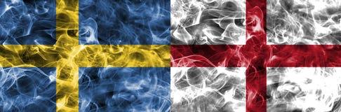 Sweden vs England smoke flag. Football royalty free stock photo