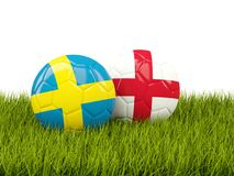 Sweden vs England. Soccer concept. Footballs with flags on green Stock Photography