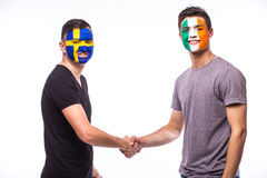 Sweden vs Republic of Ireland handshake of equal game on white background. Stock Images