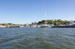 Sweden westcoast outside Gothenburg. Beutiful little harbour and small boathouse Stock Image