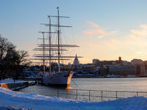 Sweden - winter Stockholm - sailing ship near quayside at sunset Stock Photo