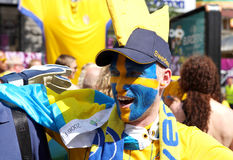 Swedian football fan with painted face Royalty Free Stock Photography