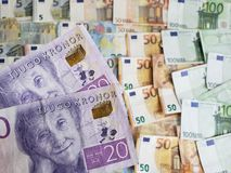 Swedish banknotes and euro bills. Europe, european, sek, sweden, kronor, crowns, commerce, exchange, travel, trade, trading, value, buy, sell, profit, price stock photo