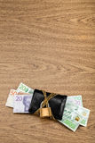 Swedish banknotes sticking out from a locked black wallet. Royalty Free Stock Image