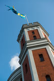 Swedish banner on a tower. A Swedish banner towards blue skyes at the top of a military tower royalty free stock images