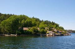 A Swedish beach house. A summer house located very close to the water on an island outside of Strömstad on the Swedish west coast Stock Photography