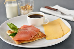 Swedish breakfast. With salmon, lettuce, cheese, coffee, muesli, and milk Stock Photo