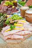Swedish buffet- meat and fruits appetizers Stock Photography