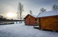 Swedish cabins in winter colors Royalty Free Stock Photos
