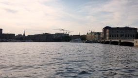 Old town of Stockholm, Sweden during the summer. Swedish capital, Stockholm. Old buildings on a small island. A few clouds in the sky stock footage